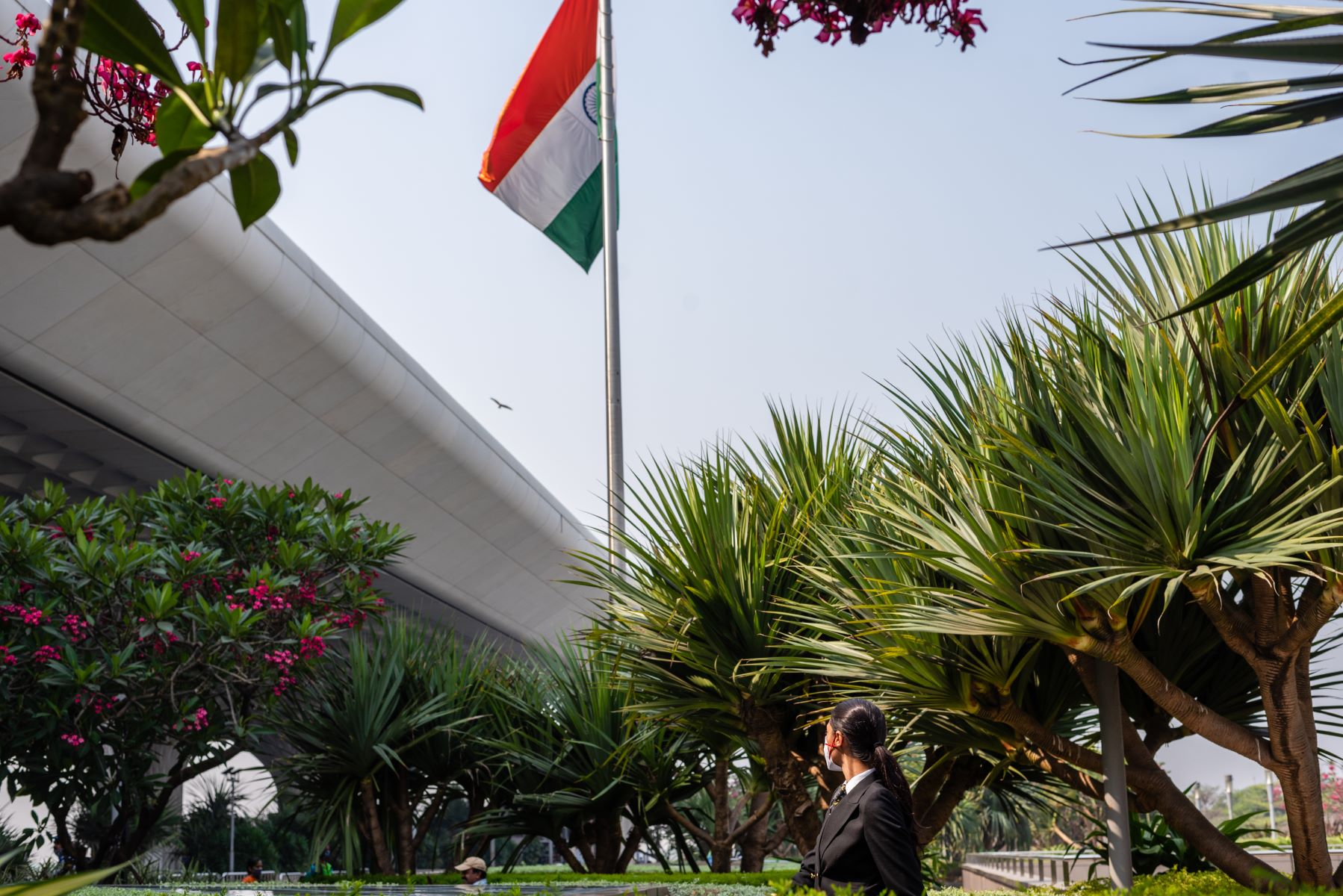 Captain Thind in front of the Indian flag at Mumbai's Chhatrapati Shivaji Maharaj International Airport.