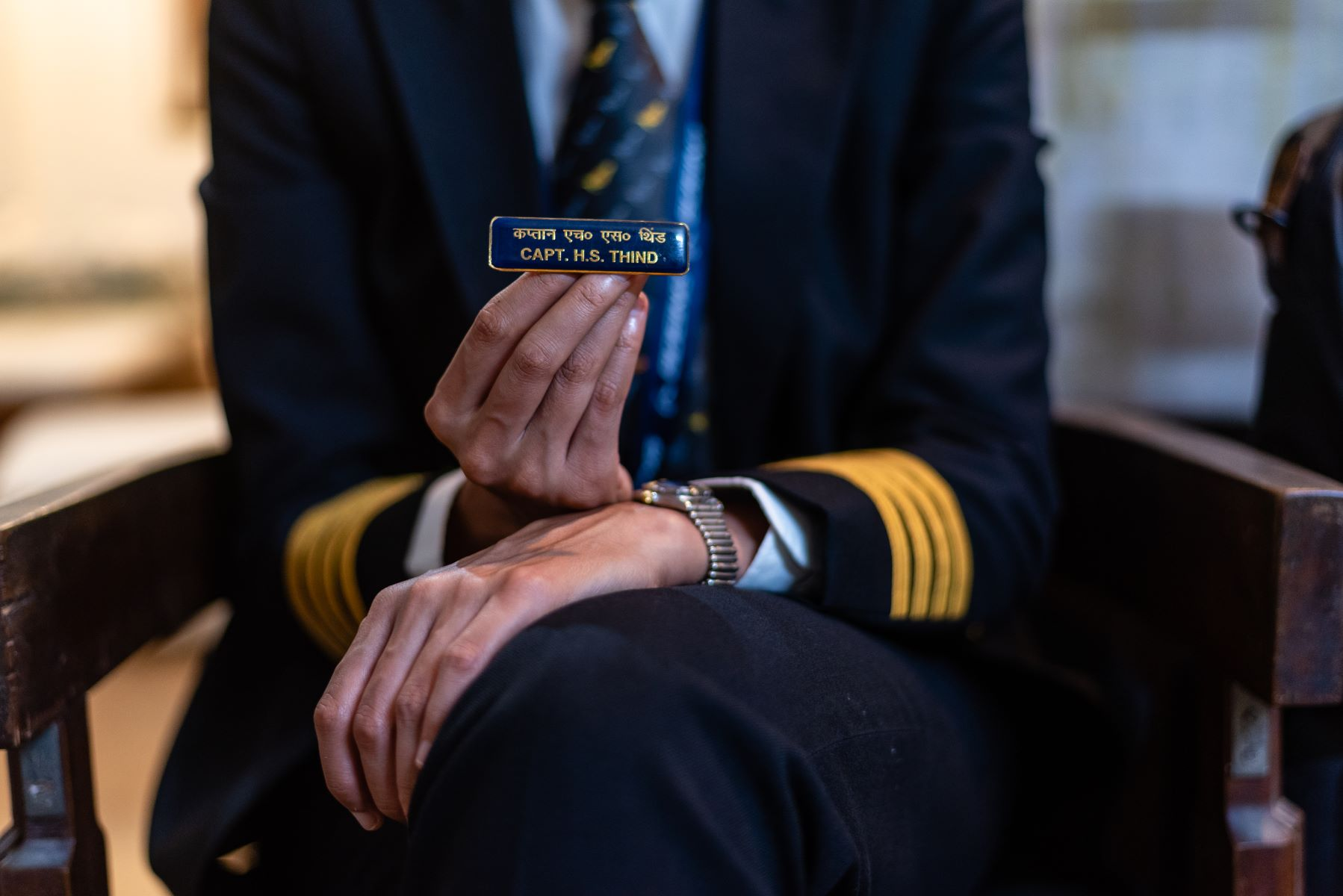 Holding a badge that belonged to her father, Captain Thind has it pinned on her flight bag at all times.
