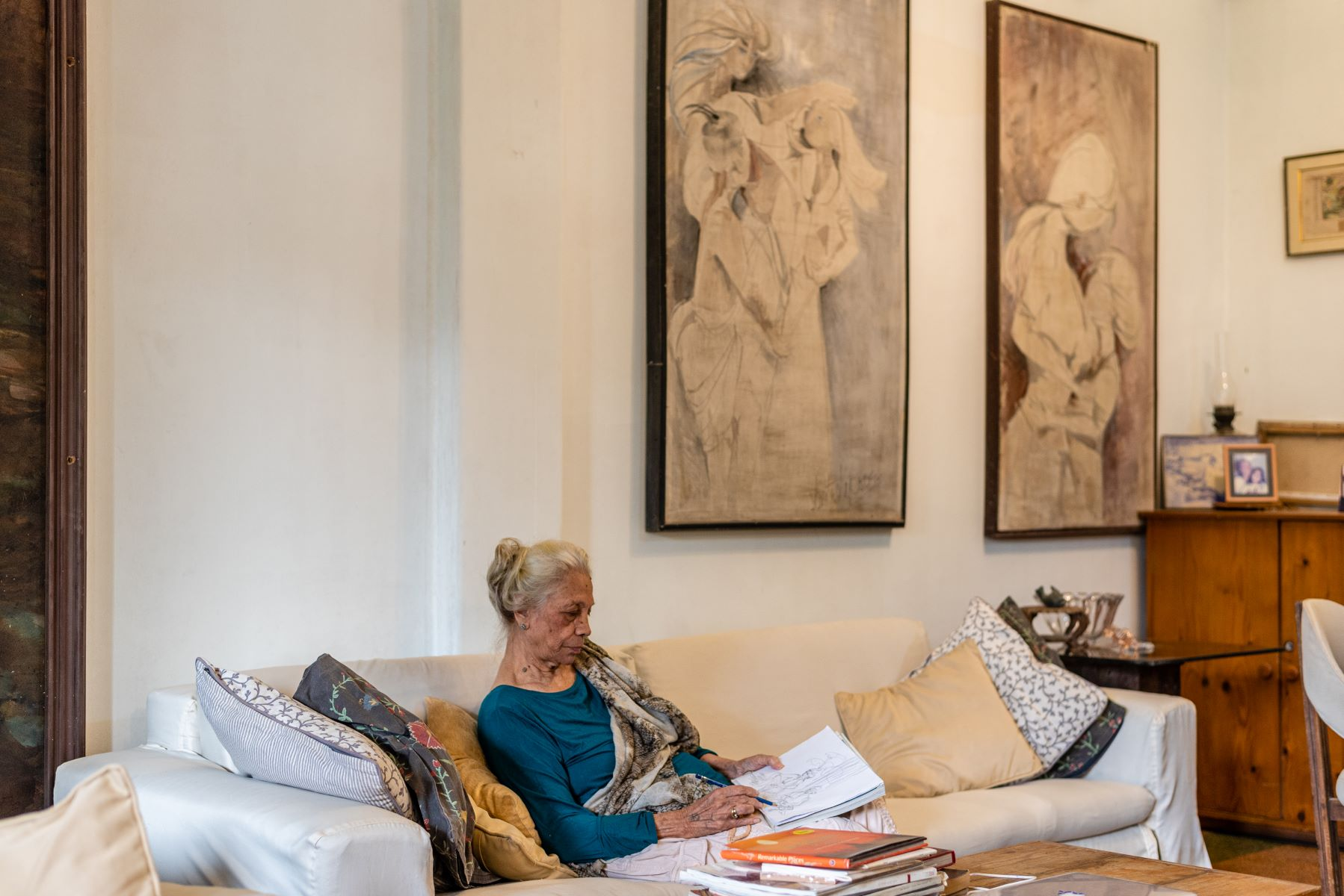 Dr. Kapoor sketching in her living room in Mumbai.
