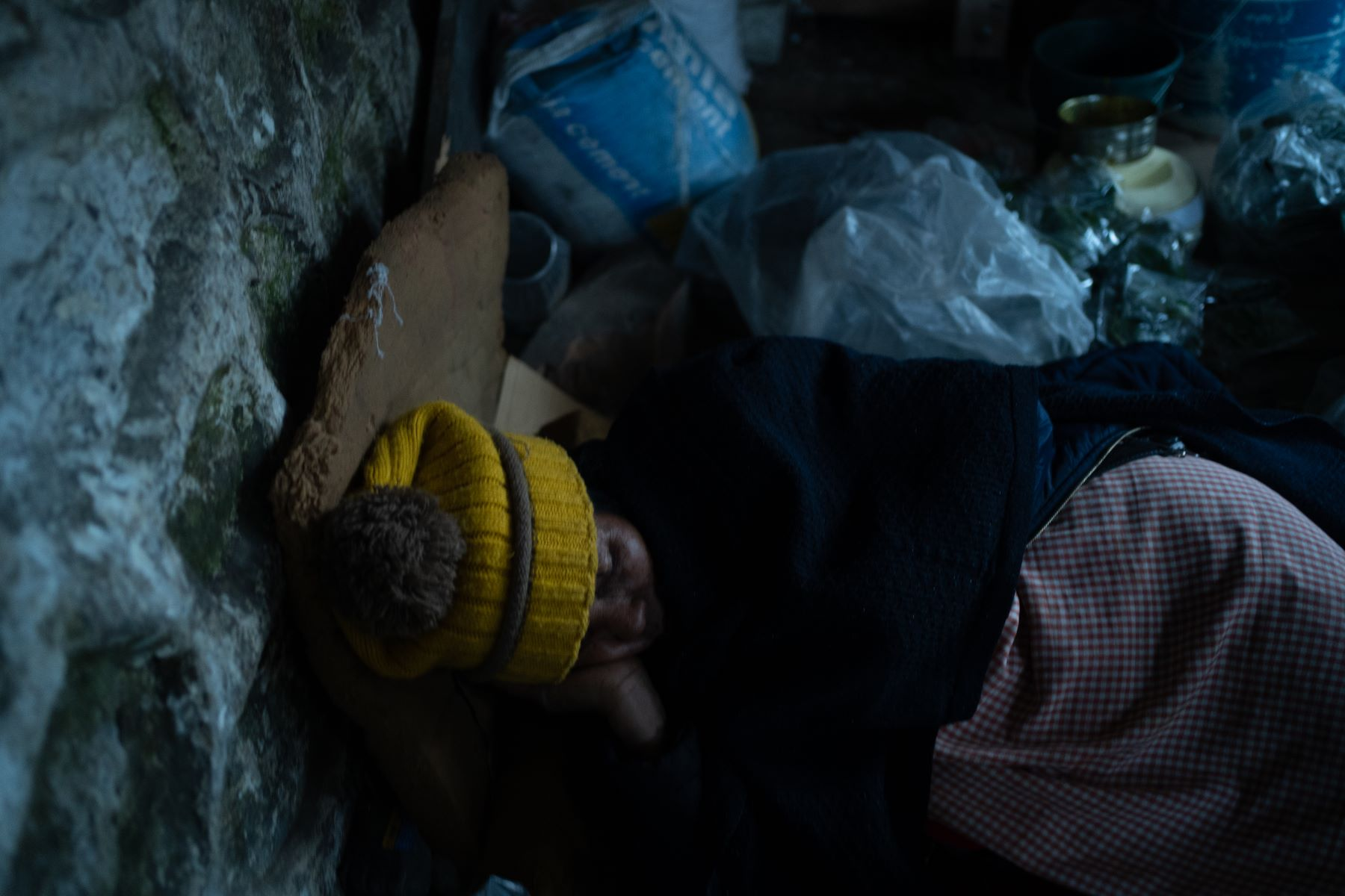 Kong Priyolyne taking a nap in her shop