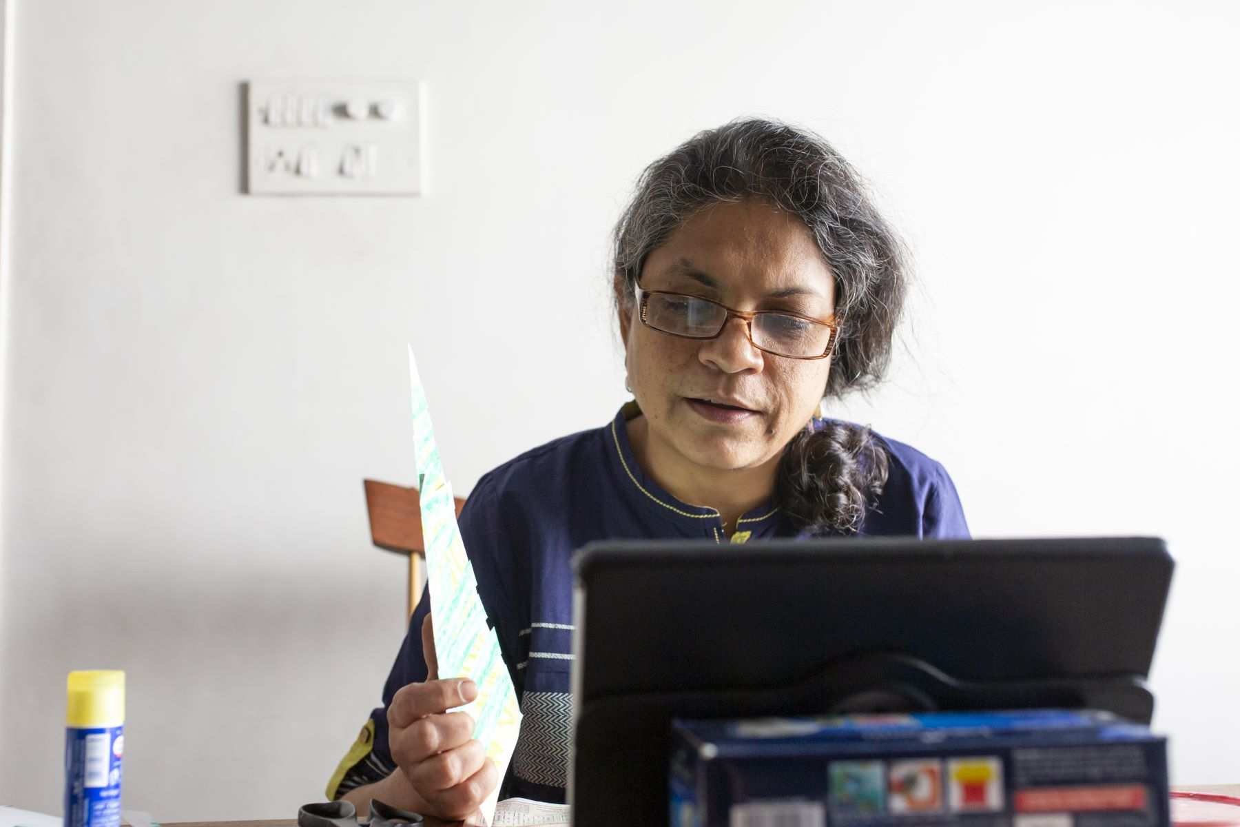 Jyotsna Srinivasan showing Madhav what needs to be done that day on a zoom call