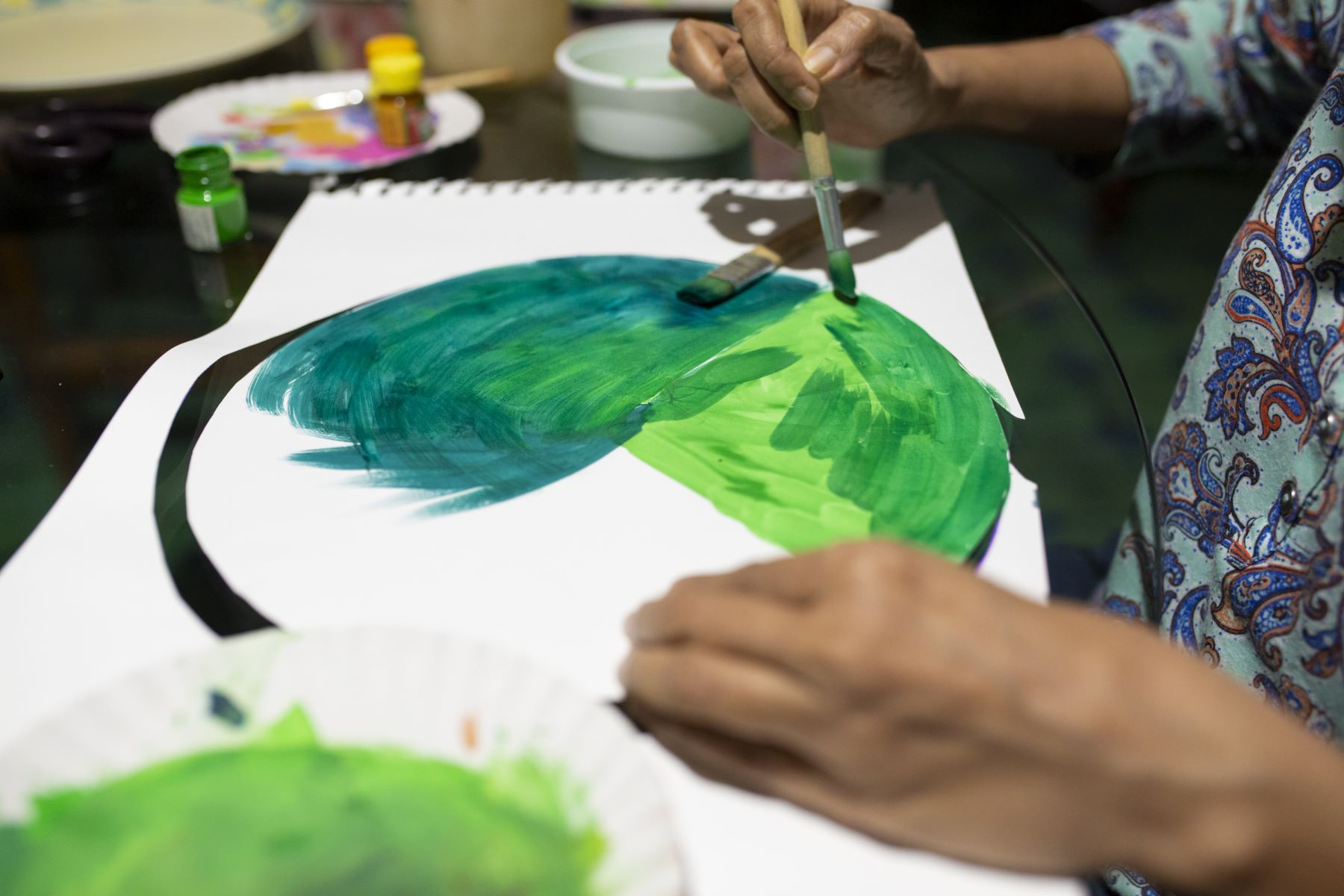 Mala painting along with Rishi during the art class