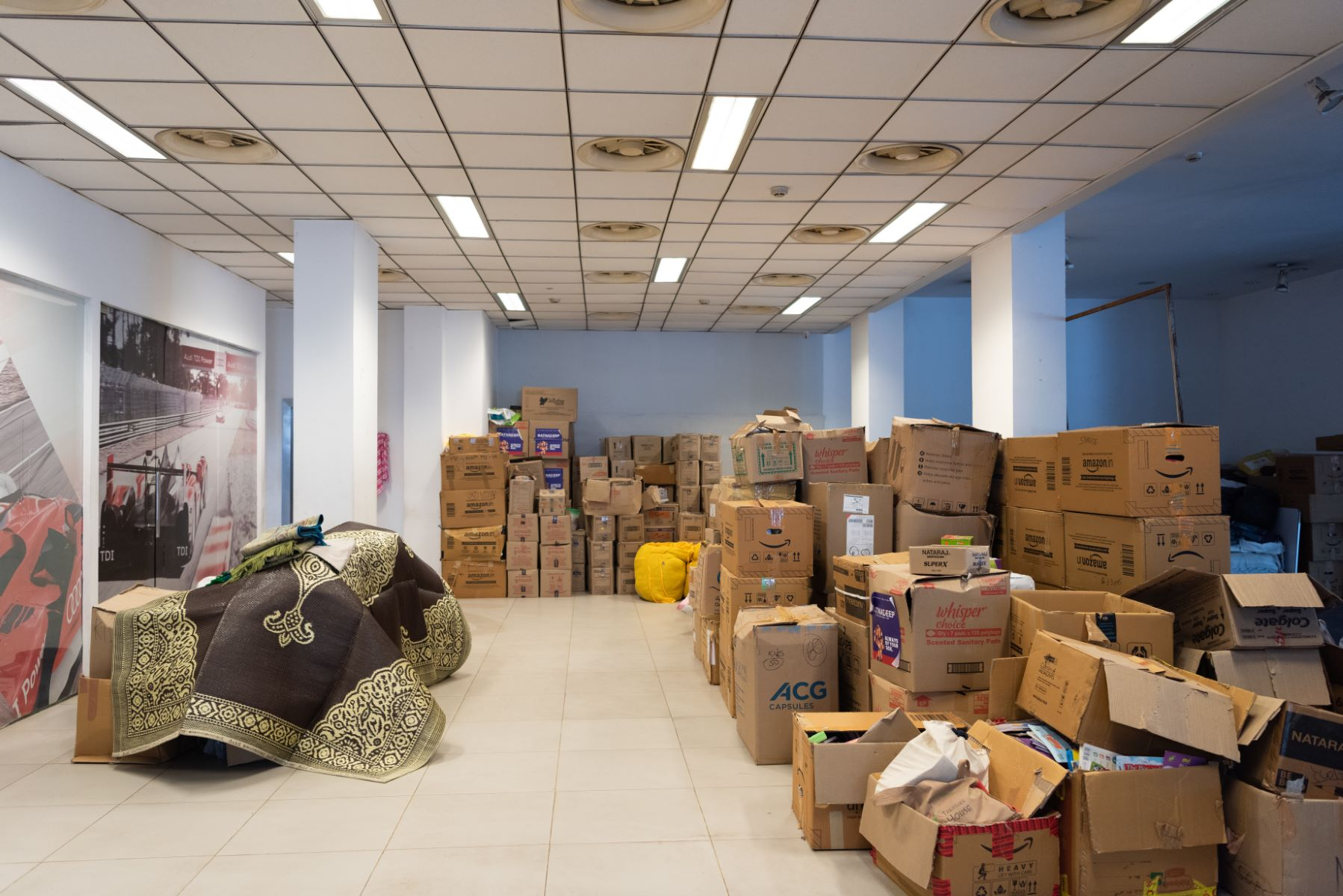 Truckloads of clothes, toiletries, and ration were sorted into kits as part of the relief efforts