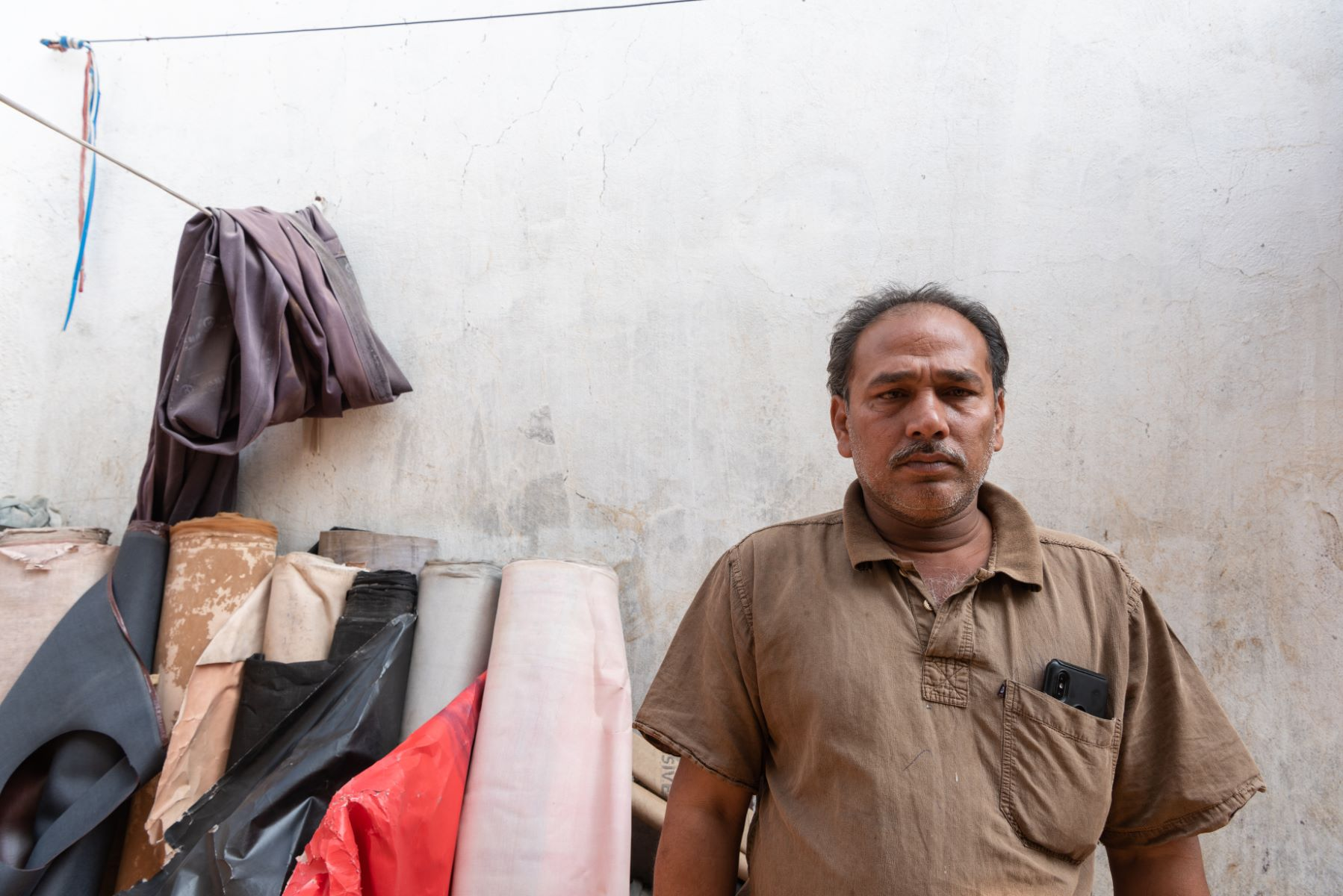 Rexine trader's Sheikh Ahmed Hussain flood-affected business was identified by SDIF for support