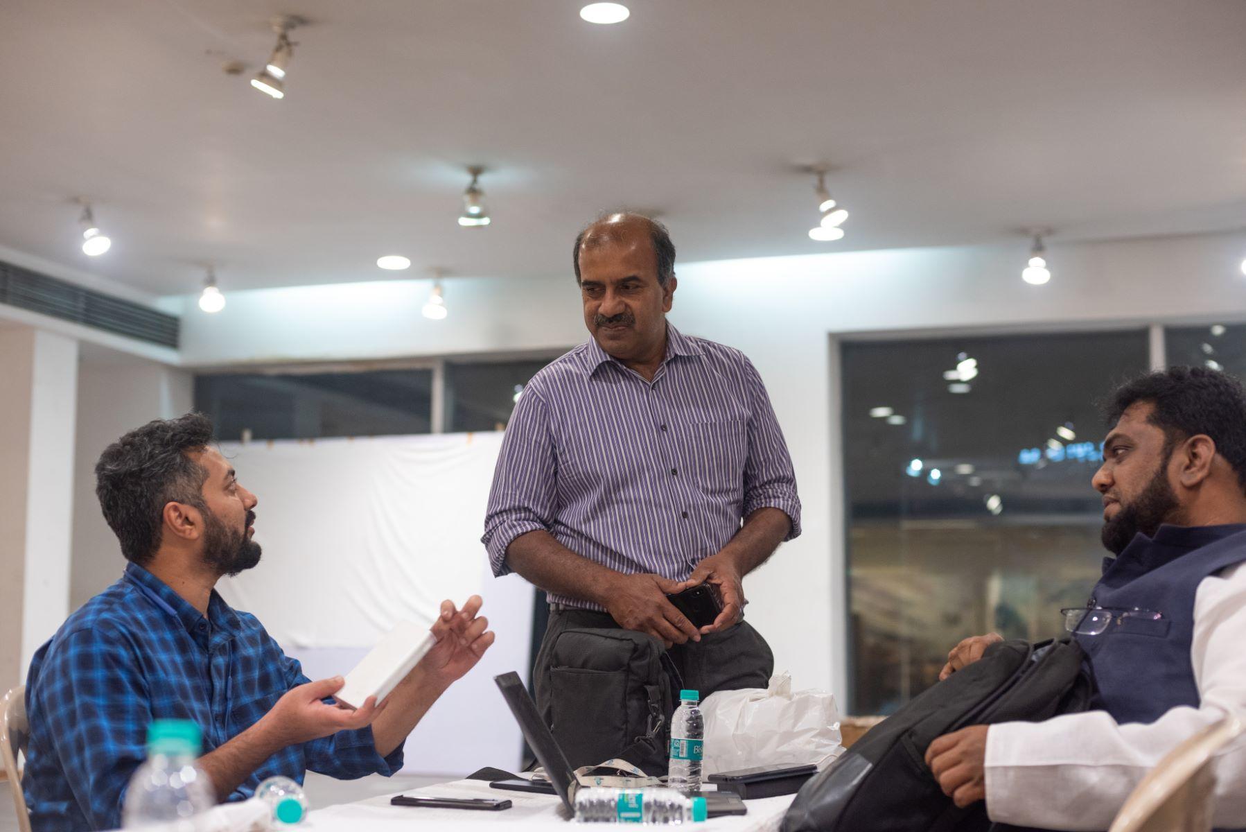 Azam Khan discusses flood relief work with SDIF co-founder Khalid Saifullah, and Feroz Baig