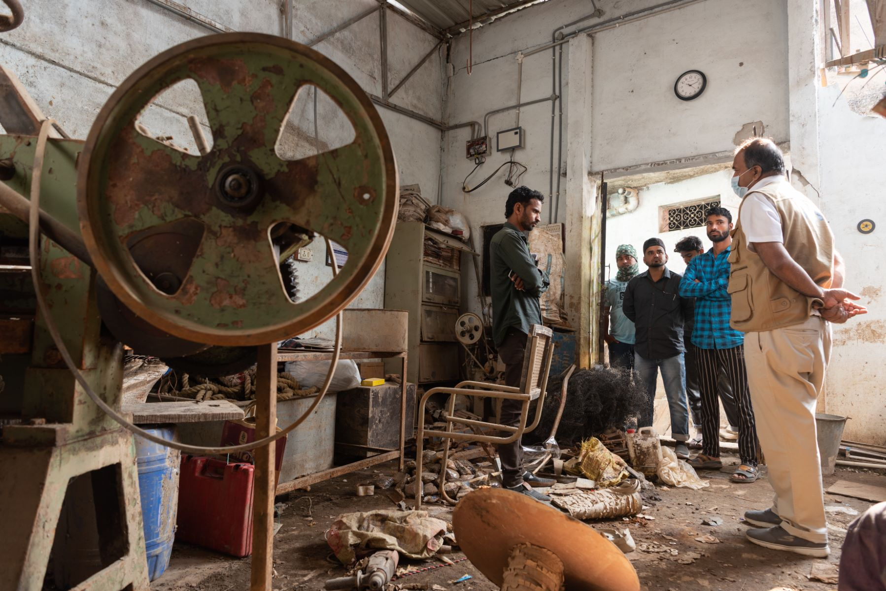 Azam Khan and volunteers help businesses affected by the floods, like this printing press