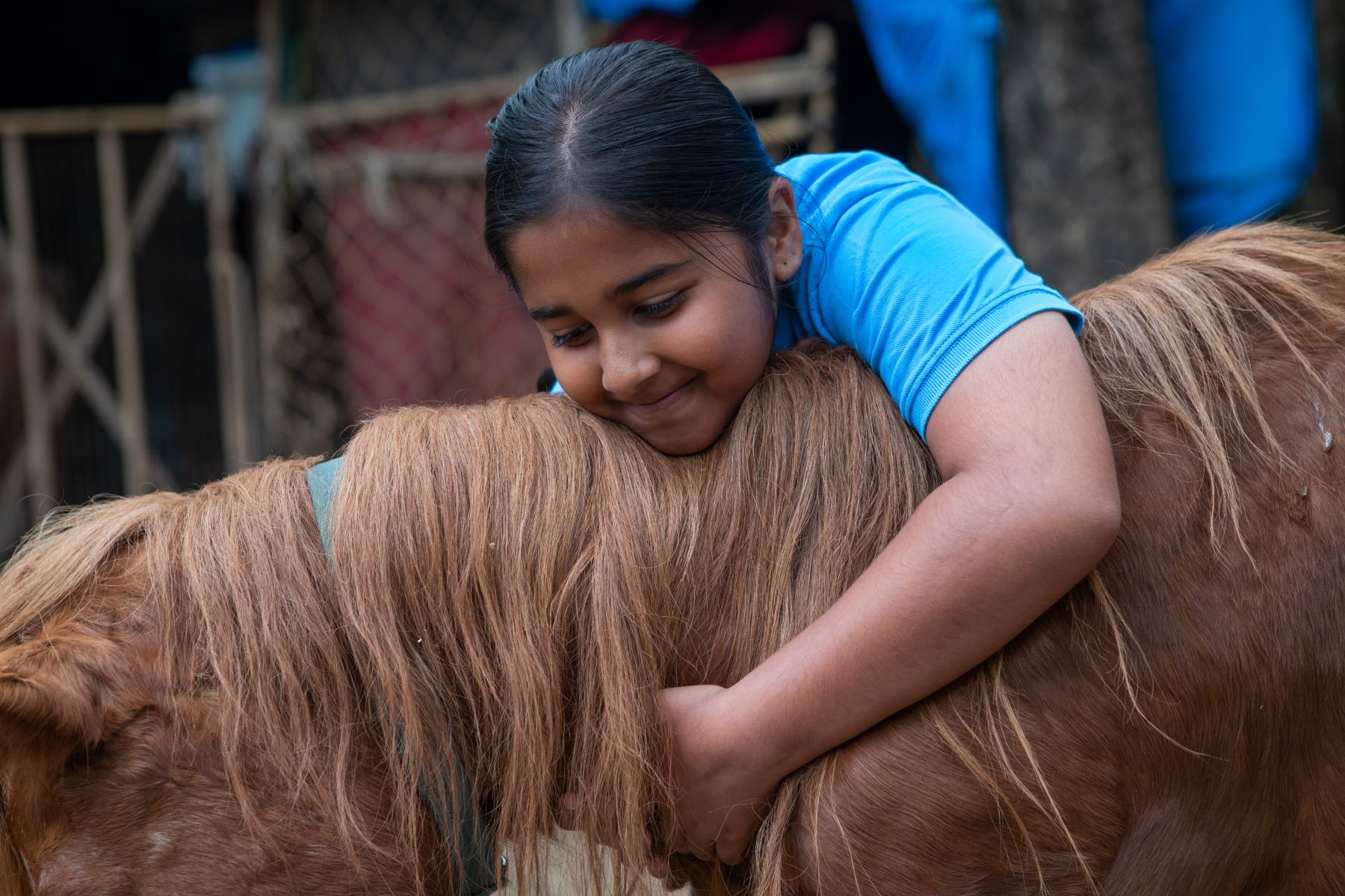 Simhasthita Singh with one of her favourite ponies Sultan at Samabhava, an NGO in palace grounds, Bangalore, India