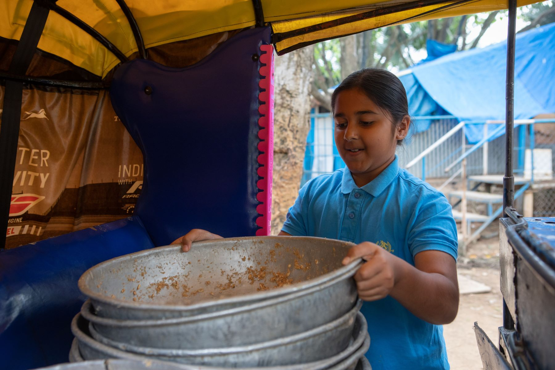 Simhasthita Singh stacks up the horse feed in an auto to feed a few of the other horses that have gone out grazing