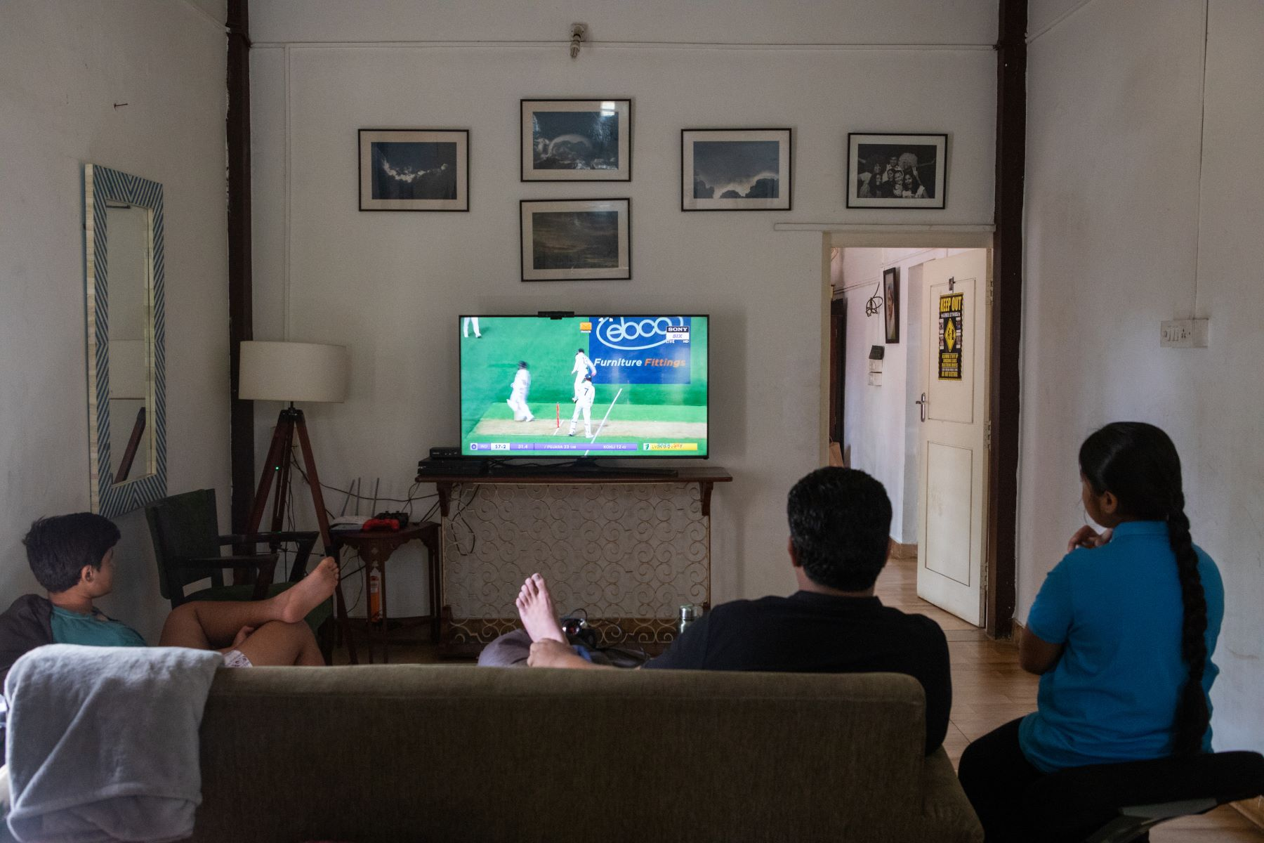 Simhasthita Singh watches the India vs Australia match with her family. She loves playing cricket and even trains at a cricket camp