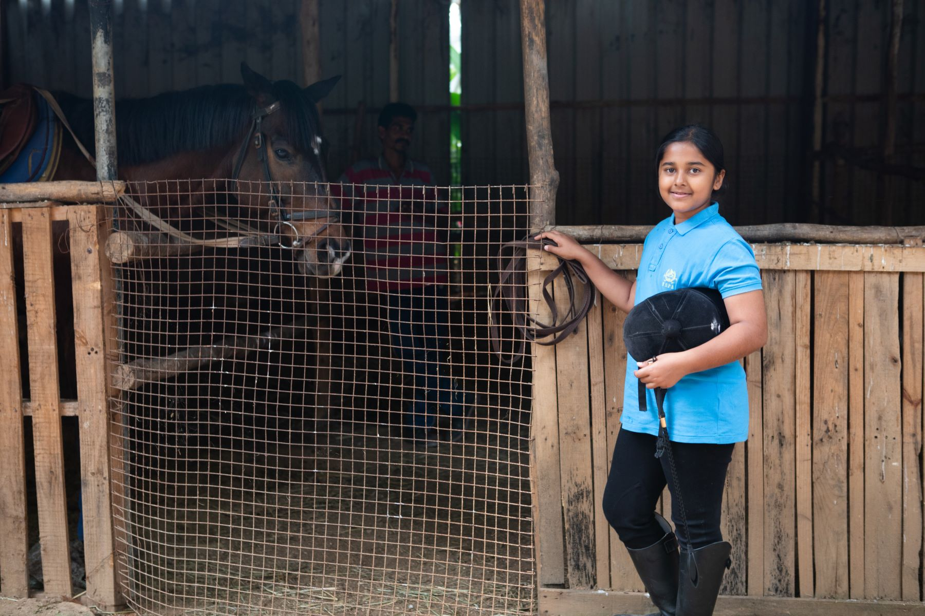 Simhasthita Singh gets Thunder ready for her riding lessons