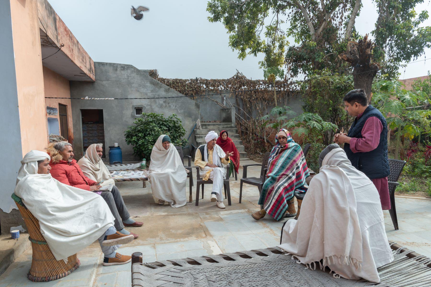 Rishi Kant at a meeting with some members of the Khap Panchayat at Dhakla village, Haryana
