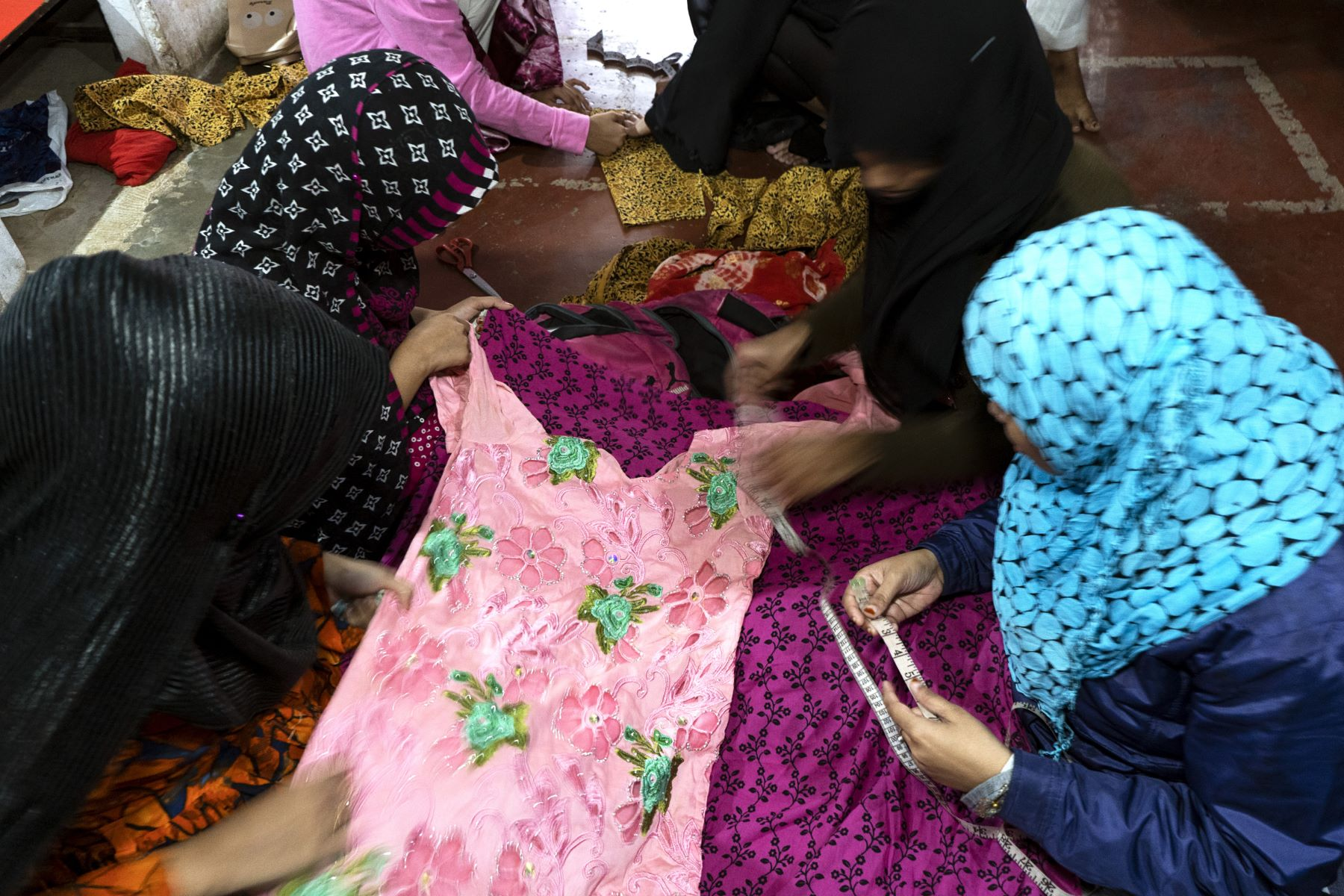 Fabric measurement and stitching at Eka's skill development workshop