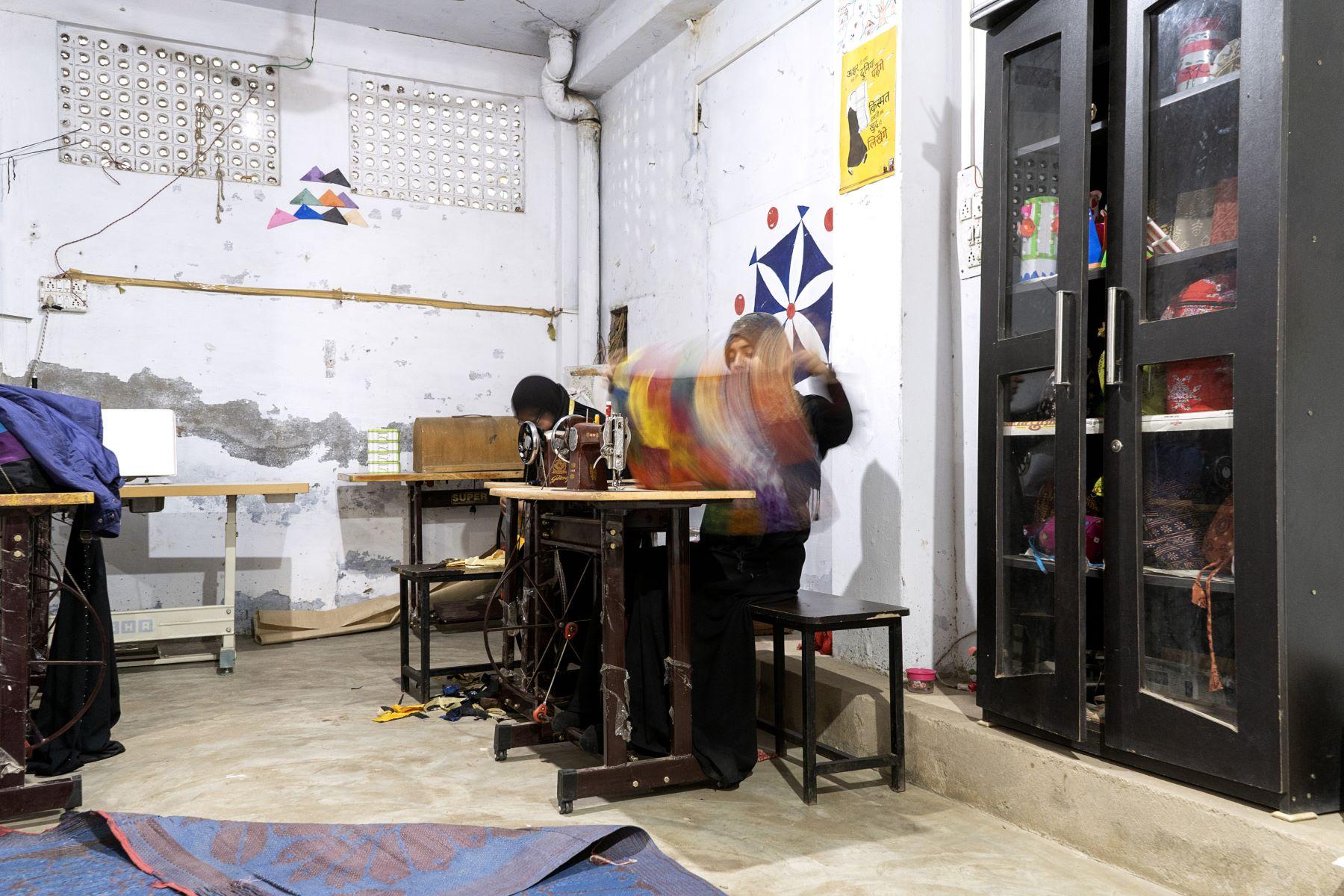 Women learning to stitch at Eka